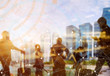 canvas print picture Business and modern technology concept. Double exposure of silhouetted people in city with wireless connection icons. Global communication.