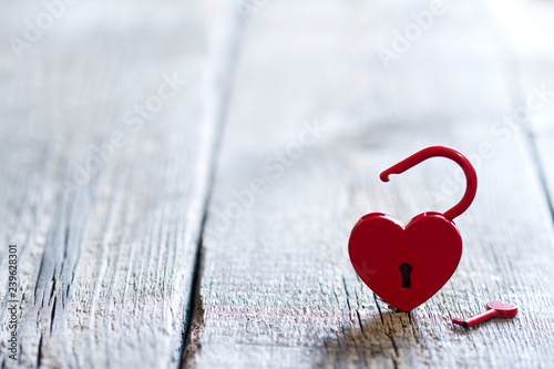 Open your heart valentines abstract love background concept with key  and red padlock on wooden free space