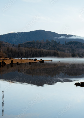 Foto op Canvas Paarden reflecting lake in the mountains