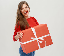 Portrait Of Woman In Red Holding Big Gift Box.