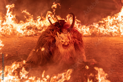 Fire red. In the flames. Krampus, Christmas devils
