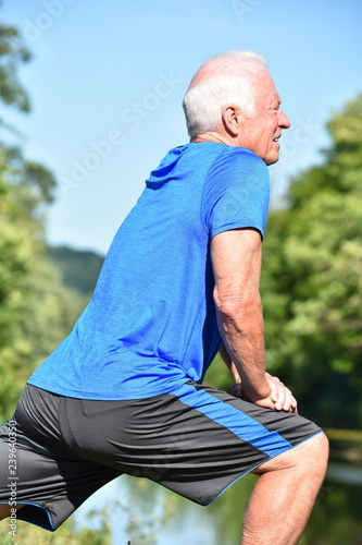 Fotografie, Obraz  Athletic Male Senior Stretching Outdoors