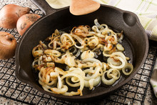 Roasted Onions In A Cast Iron Pan