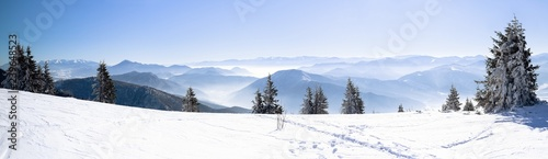 Obraz na plátně  Panorama of snowy winter mountain, Alpine mountains in winter, Beautiful winter
