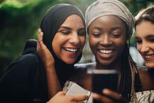 Smiling Friends Taking Selfie ...