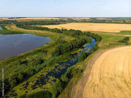 Fotografía  Natural landscape of central Russia with field, river in August
