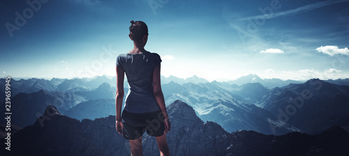 Fotografiet  Young woman observing mountain landscape