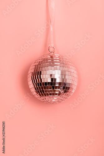 Fototapeta Christmas disco ball hanging on pink. Creative Xmas pattern. obraz