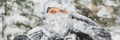 portrait man head covered by heavy snow on a winter day f