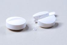 Dosing,  Halve White Antibiotics Pill