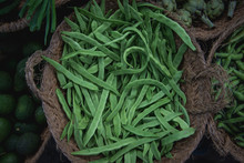 Fresh, Raw Green Beans In The Market In A Basket