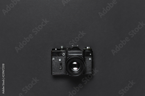 Obraz Old retro vintage camera on black background top view flat lay with copy space. Concept for the photographer, old photographic equipment, minimalistic style selective focus - fototapety do salonu