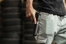 Close-up Of Man Holding A Pistol