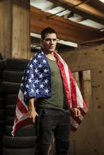 Portrait Of Man Wearing American Flag Holding A Gun