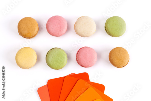 Obraz French macarons and red orange color swatches on white background - fototapety do salonu