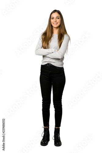 Obraz Full-length shot of young girl keeping the arms crossed in frontal position on isolated white background - fototapety do salonu