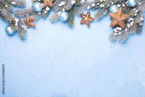 Fotografie, Obraz  Decorative branches fir tree, golden stars and blue balls  on blue textured  background
