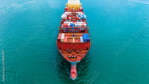 Fotografia  Container ship carrying container for import and export, Aerial view business logistic and freight transportation by ship in open sea