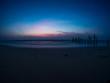 sunrise at the sand beach with broken wood bridge