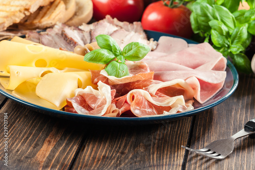 Cold meat platter with ham, prosciutto, bacon and cheese
