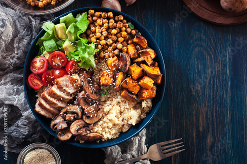 Leinwand Poster Vegetable buddha bowl lunch with chicken and quinoa, chickpea, mushrooms, lettuc