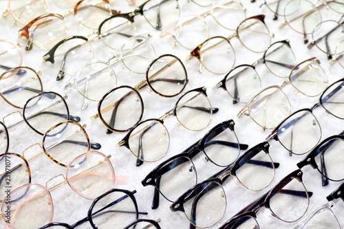 Obraz Glasses, Eyeglasses Optical Store, Fashion eyewear at night market, Colorful glasses, Glasses on shelf, Glasses in optical store shopping mall (Selective Focus) - fototapety do salonu