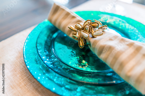 Fotografie, Obraz  Macro closeup of decorated table plate setting with blue colors and vibrant napk