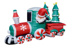 Isolated Inflatable Santa Train Lawn Decoration Delivering Christmas Trees.