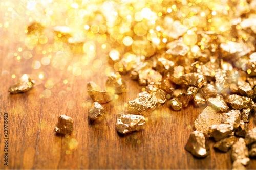 Vászonkép Gold nuggets on background. closeup