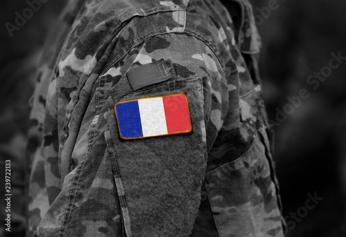 Fotomural  Flag of France on soldiers arm (collage).
