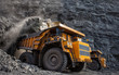 canvas print picture - mining truck in a coal mine loading coal