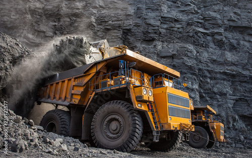 Photo mining truck in a coal mine loading coal