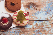The Colorful Christmas  Round Donuts On Wooden Table Painted Blue Background Party Idea
