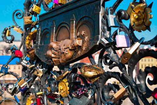 Poster PRAGUE, CZECH REPUBLIC - March 09th, 2014: Love locks on the Charles Bridge. Historical sculptures on the Charles Bridge. The site of the death of St. John Nepomucene