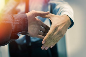 greeting and agreement of the hands of business people