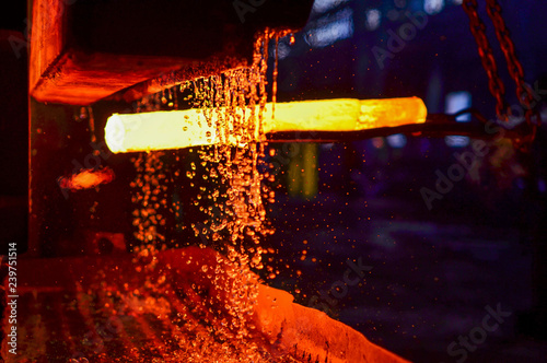 Photo The process of forging metal in the production of heavy molded metal products