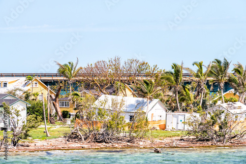 Many damaged, destroyed houses on beach by shore, coast in Florida keys, bridge after, aftermath of destruction of hurricane irma, houses after storm heavy wind