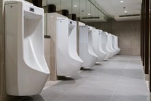 The Toilet Of Man With Row Of ...