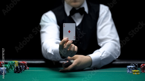 Photo  Casino croupier showing ace card in front of camera, poker game shuffling tricks