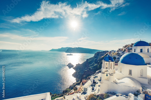 Poster de jardin Santorini Churches in Oia, Santorini island in Greece, on a sunny day.
