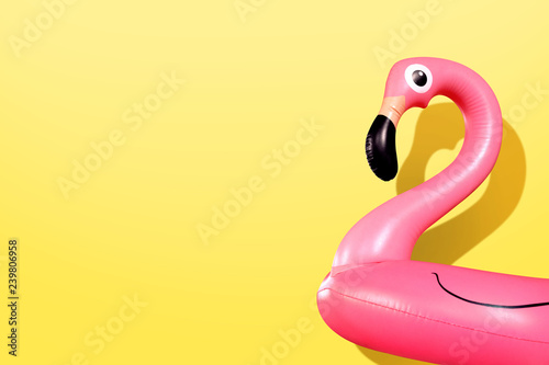 Tuinposter Flamingo Giant inflatable Flamingo on a yellow background, pool float party, trendy summer concept