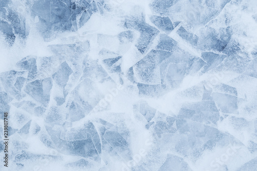 Canvas Prints Marble Close-up of snow on cracked and thin layers of ice in the winter. Simple and minimal full frame abstract background. Copy space.
