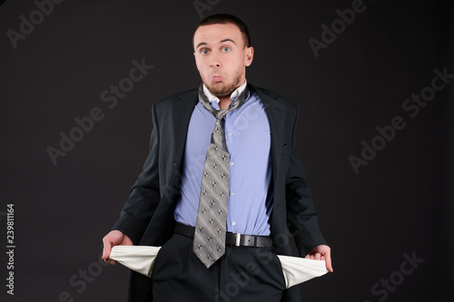 Canvas Print businessman turning his empty pockets inside out after tax audit or collector visit