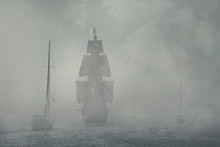 Yachts And A Pirate Ship In The Fog.