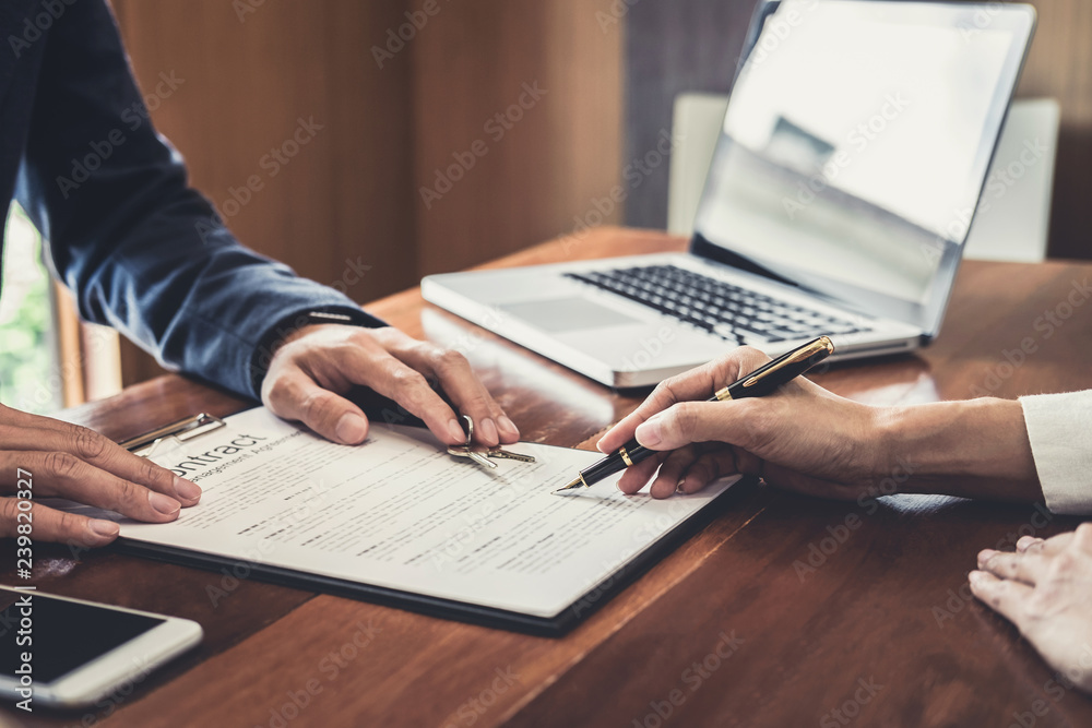 Fototapeta Sales manager filing keys to customer after signing rental lease contract of sale purchase agreement, concerning mortgage loan offer for and house insurance