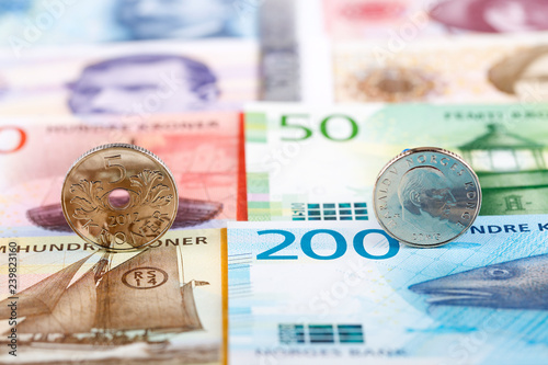Photo  Norwegian coins on the background of banknotes