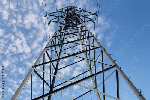 фотография  Power lines on metal poles against a blue sky