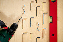 Pattern Background Of Various Allen Keys With Drill And Level Spirit On  Wooden Work Table