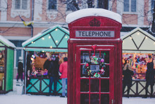 Red Classic Phone Booth In Winter Snowing Season Weather Time And In Christmas Fair City Environment