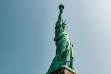 Liberty Statue In New York City With Skyline Of The Island Of Manhattan